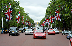 Image &copy;Licensed to i-Images Picture Agency. 18/06/2014. <br /> <br /> Nine Porsche 944's, all bought for &pound;1100 of less, set of from the Mall, London on a rally across Northern Europe to Nordkapp in Norway in an attempt to raise &pound;100,000 for Help For Heroes.<br /> <br /> Wednesday 18th June 2014<br /> Picture by Ben Stevens / i-Images