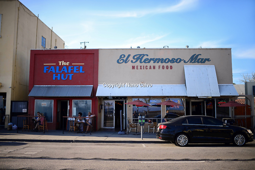 The Falafel Hut and El Hermoso Mar restaurants at Santa Cruz boardwalk, California.