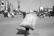 A young garbage picker in the streets of Karachi. Pakistan, 2009