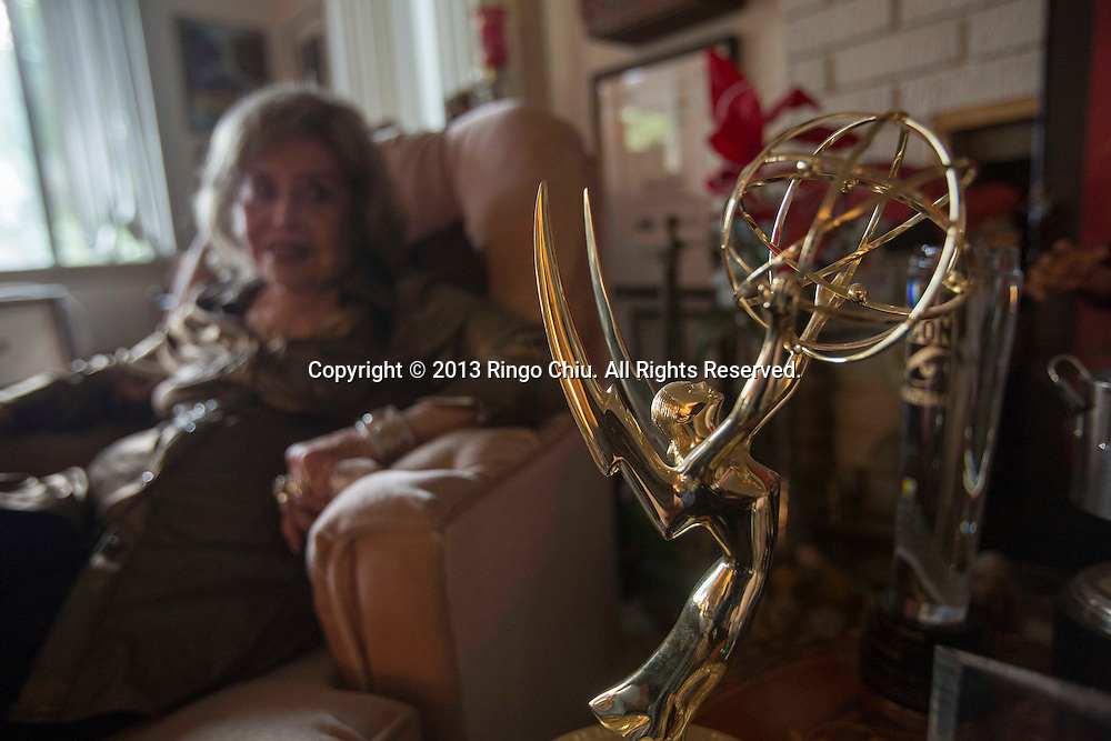 Voice actress June Foray, 96, looks on as an Emmy Awards statue is siting at her home in Woodland Hill, Calif., Tuesday, Dec. 17, 2013. Foray was the voicce of Cinfy-Lou Who in the original 1966 Grinch Cartoon. (Photo by Ringo Chiu/For TheToronto Star)