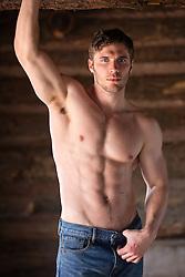 shirtless muscular man in a cabin