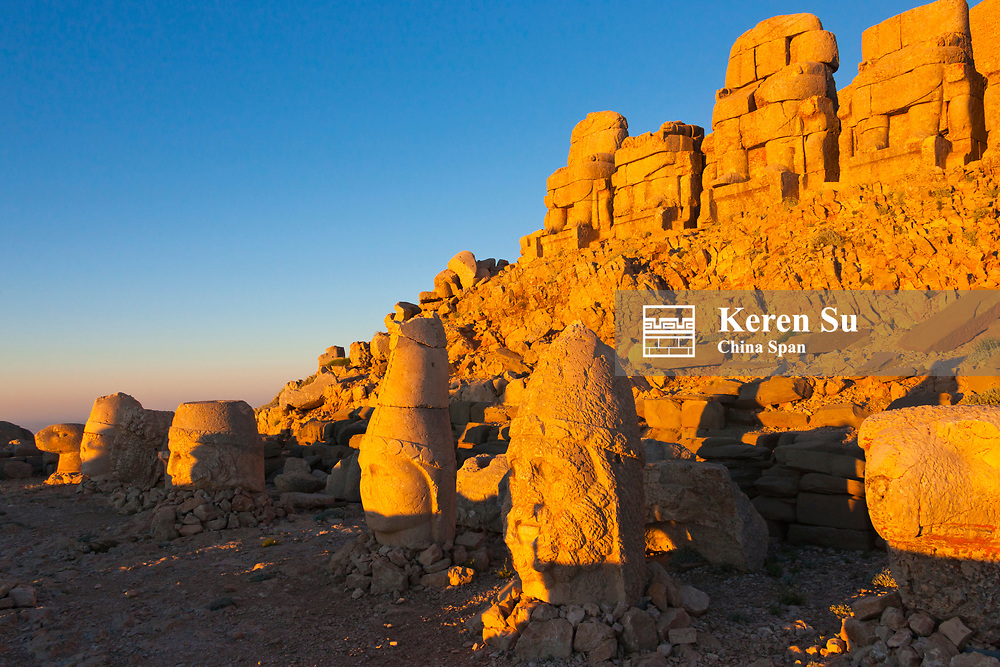 Statue of head at sunrise on the eastside of the mountain, Mt. Nemrut, Turkey
