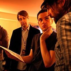 The post-punk band The Killers perform at the Hammerstein Ballroom at Manhattan Center Studios in New York, N.Y. on Oct. 24, 2008. Second to right, singer Brandon Flowers discusses the set list with their tour manager backstage before their show.