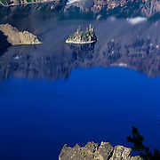 Along the edge of Crater Lake in the Cascade Mountains, Crater Lake National Park, OR.