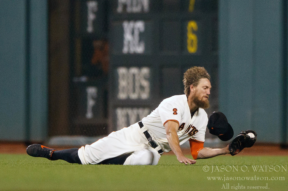 SAN FRANCISCO, CA - SEPTEMBER 29:  Hunter Pence #8 of the San Francisco Giants dives for but is unable to catch a fly ball hit off the bat of Cristhian Adames (not pictured) of the Colorado Rockies for a single during the ninth inning at AT&T Park on September 29, 2016 in San Francisco, California. The San Francisco Giants defeated the Colorado Rockies 7-2. (Photo by Jason O. Watson/Getty Images) *** Local Caption *** Hunter Pence