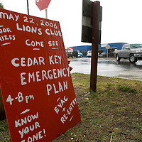 A sign advertises a hurricane preparedness meeting as residents of Cedar Key, Florda prepare for Tropical Storm Alberto June12, 2006. REUTERS/Scott Audette