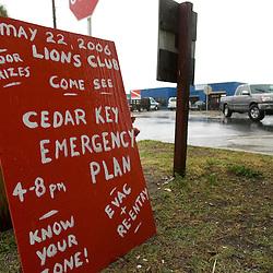 A sign advertises a hurricane preparedness meeting as residents of Cedar Key, Florda prepare for Tropical Storm Alberto June12, 2006. REUTERS/Scott Audette