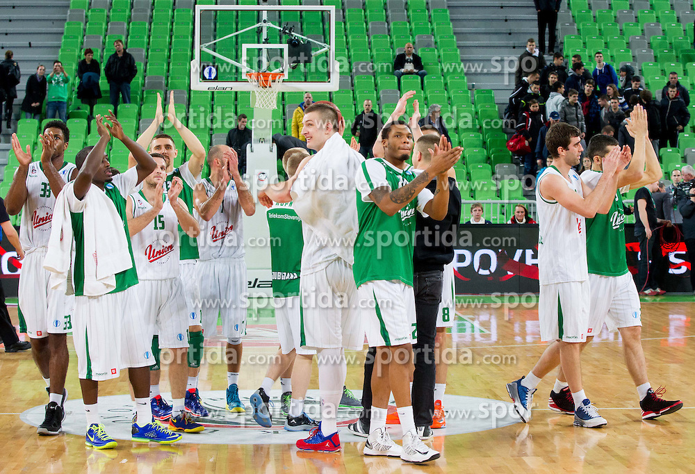 Players of Union Olimpija celebrate after the basketball match between KK Union Olimpija Ljubljana and Asvel Villeurbanne Basket (FRA) in Round 7 of EuroCup 2013/14, on November 27, 2013 in Arena Stozice, Ljubljana, Slovenia. Photo by Vid Ponikvar / Sportida