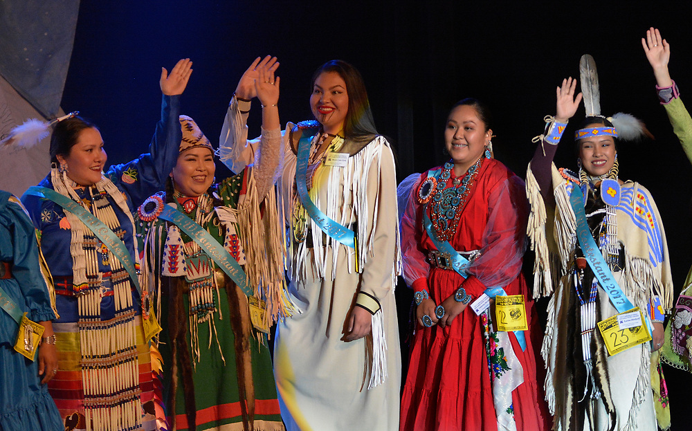 gbs042717e/ASEC -- Miss Indian World Contestants, from left, Kelly Walker, Arikara/Hidatsa/Comanche, of Lawrence, Kansas, Shandiin Nanamkin-Spencer, Colville Confederated Tribes of Keller on the Colville Reservation, Washington, Becca Lynn Kirk , Klamath/Leech Lake Ojibwe/Warm Springs Wasco, of Portland Oregon, Valentina Blackhorse, Navajo Nation, of Kayenta, Arizona and Katrina Blackwolf, Confederated Tribes of Warm Springs and Yakama Nation, of Warm Springs Indian Reservation, Oregon acknowledge the audience during the start of the competition in the Albuquerque Convention Center's Kiva Auditorium on Thursday, April 27, 2017. There are 23 contestants in the pageant. (Greg Sorber/Albuquerque Journal)