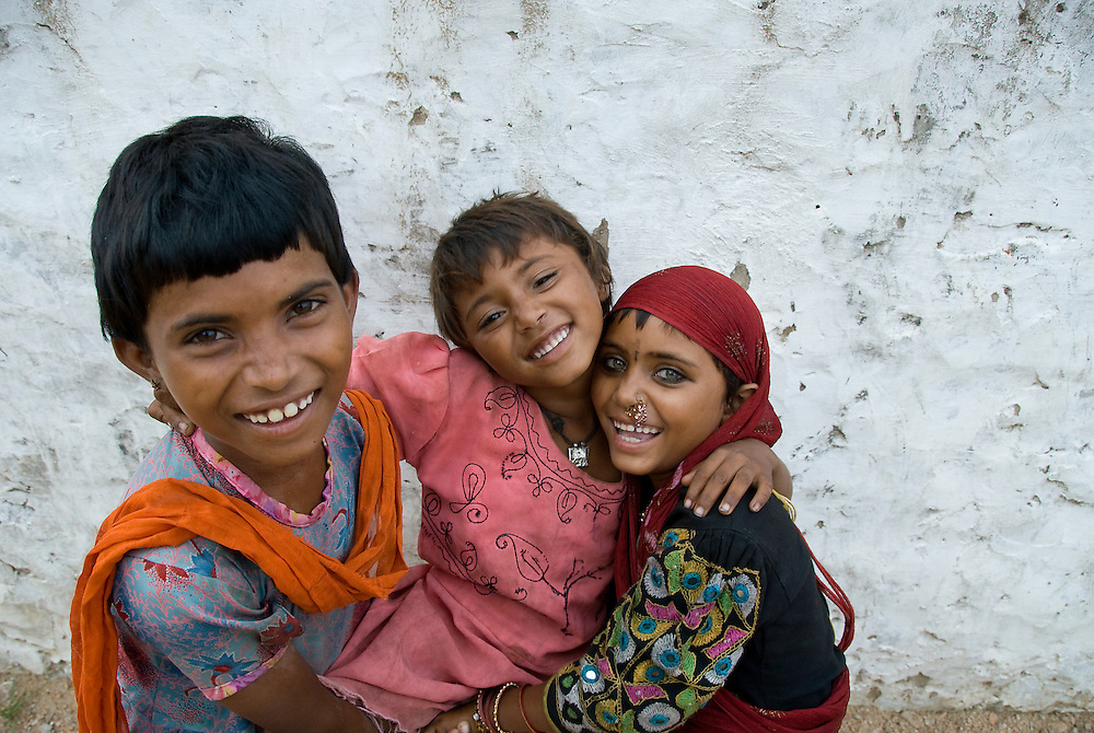 Happy sisters wearing traditional Rajasthani dresses. (Thar desert, Rajasthan, India)