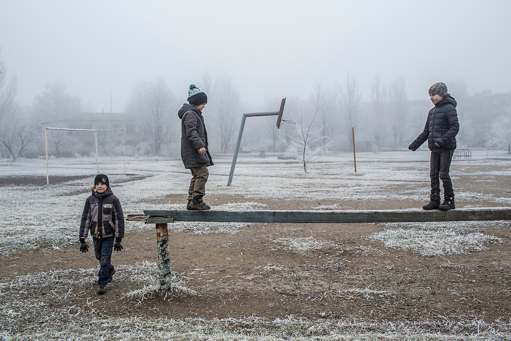 Students play on the school athletic field on Saturday, December 12, 2015 in Zolote, Ukraine.
