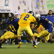 Blue's George Murray (81) of Caravel Academy and Blue's Jeffery May (3) of Hodgson Vocational High School attempt to tackle Gold Aaron Moore (2) of Indian River High School near the 35 yard line in the fourth-quarter of the 58th Annual DFRC Blue-Gold All?Star Football game Saturday, June. 22, 2013, at Delaware Stadium in Newark DE.
