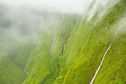 Rain falling on the summit of Kauai, Hawaii, one of the wettest places on Earth, falls over 900 meters (3000 feet) into the Blue Hole, a deep box canyon formed by erosion below Mount Waialeale.