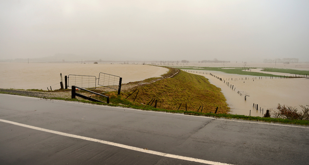 A stop bank on the Hikurangi Swamp drainage scheme nears capacity in flooding caused by the severe easterly storm buffeting Northland, New Zealand, July 10, 2014.  Credit:SNPA / Malcolm Pullman