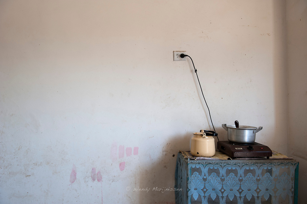 A pot of lentils is cooking on the one pit stove in Zebynisso's home. 28 year old Zebynisso is an MDR TB patient and her 2 year old son Hassan is suspected of having the same form of TB. The MSF team will examine and monitor the baby and start treatment.
