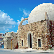 """See Mosque of the Janissaries, on the Old Harbor of Hania (Chania), on the island of Crete, in Greece, Europe. Mosque of the Janissaries was built in 1645, when Hania fell to the Turks, and is the oldest Ottoman building on Crete. GREEK HISTORY: The Greek War of Independence of 1821-1829 reclaimed Ottoman Turk holdings in the Peloponnese, Sterea Ellada, and the Cyclades & Sporades Islands, but intervention by Britain, France, and Russia would set up foreign kings to control Greece on and off for generations. With Ottoman decline in the mid-1800s, the """"Megali Idea (Great Idea)"""" of a new Greek Empire became popular for reclaiming former Byzantine Greek lands. Balkan Wars of 1912-1913 expanded Greece to include southern Macedonia, part of Thrace, more of Epiros, North-East Aegean Islands, and union with Crete. After siding with the Allies in World War I, Greece invaded Turkey as far as Ankara. But the young General Mustafa Kemal (later called Ataturk) drove the Greeks out of Anatolia. In a stressful exchange, 1.5 million Christians left Turkey and 400,000 Muslims left Greece. Greece suffered terribly under Nazi occupation in World War II due to starvation, and death camps for half the Jews. Greece's turbulent history culminated in a 1946-1949 Civil War between monarchists and democrats, where more Greeks were killed than in World War II. Despair motivated nearly a million Greeks to seek better life in Australia (Melbourne), Canada, USA (New York & Chicago), and elsewhere. After a coup by Colonels 1967-74 and later socialist rule, Greece shifted politically rightwards by 2001. Greek standard of living rose rapidly; low interest rates expanded car ownership. Greece proudly hosted the lightly attended 2004 Olympic Games in Athens, seen on worldwide TV by 3.9 billion viewers. In 2010-12, debt crisis made Greece agree to Eurozone & IMF loan rescue with harsh austerity measures."""