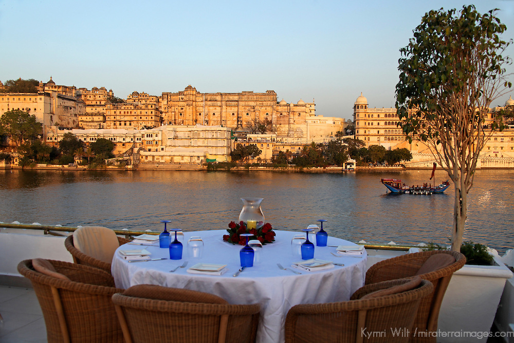 Asia, India, Udaipur. Table setting on rooftop restaurant Bhairo at Taj Lake Palace Hotel.