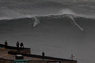 UK surfer Andrew Cotton (L) and Brazilian surfer Pedro Scooby ride a wave at North Beach during a giant swell that hit the Portuguese coast today at Nazare, Center of Portugal, 28 October 2013. Brazilian surfer Carlos Burle surfs the tallest wave of the day. Havaiian Garrett Mcnamara's set the record for the biggest wave ever surfed on January 2013 also at Nazaré. PAULO CUNHA /4SEE