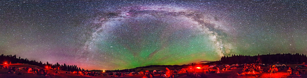 A 360° panorama of the Table Mountain Star Party, July 25, 2014, held at the Eden Valley Guest Ranch in northern Washington state. It shows the Milky Way arching overhead (zenith is at the top), and bands of airglow streaming out of the east at centre. South is to the right of centre where the bright centre of the Galaxy area meets the horizon. The Big Dipper is at the left of the frame. This is an 8-section panorama, with each section shot with a 14mm Rokinon lens in portrait format, at f/2.8 and Canon 5D Mark II at ISO 6400 for 45 seconds each, untracked. Assembled in PTGui using Equirectangular projection.