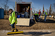 Gavin Ruehling helps carry supplies from a disaster trailer as volunteers help cleanup on Saturday, March 4, 2017, in Perryville, Mo. LCMS Communications/Erik M. Lunsford