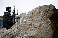 SYRIA - Homs province: A Free Syrian Army fighter takes cover during an operation against Al Assad Army in Homs province on February 22, 2012. ALESSIO ROMENZI