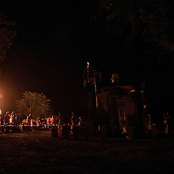 Festivalgoers check out the fire cart while the Effigy, in foreground, is being readied to burn.  Note the flame already started on the top of the Effigy.