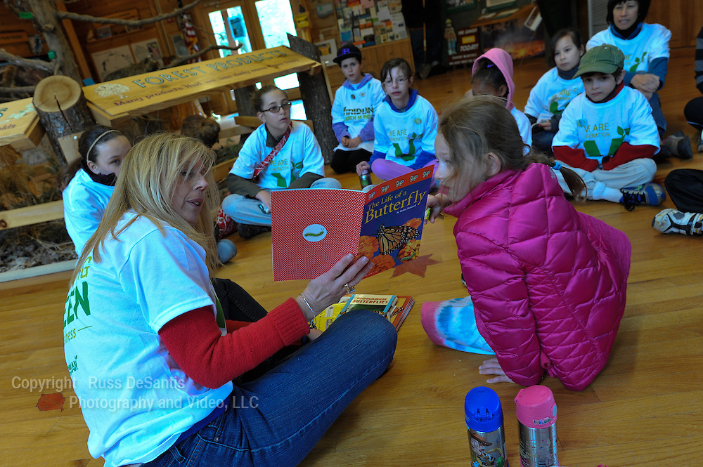 Volunteers from Viridian Energy help refurbish trails and clean signs at the Forest Resource Education Center in Jackson Twp. Children also learned about the environment. / Russ DeSantis Photography and Video, LLC