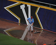 Grounds crew clears water from the field during the Southeastern Conference tournament at Regions Park in Hoover, Ala. on Friday, May 28, 2010.