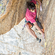 "Alex Honnold climbing the fifth pitch, a flaring 13a bombay chimney, of ""Wet Lycra Nightmare"" (13d) on Leaning Tower, Yosemite N.P."
