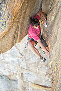 """Alex Honnold climbing the fifth pitch, a flaring 13a bombay chimney, of """"Wet Lycra Nightmare"""" (13d) on Leaning Tower, Yosemite N.P."""