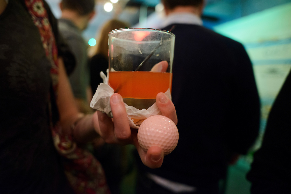 Photo by Matt Roth.Assignment ID: 10137081A..Kimberly Stoner holds her drink and mini-golf ball at H Street Country Club where patrons can play mini golf on a D.C. themed course while they grab a drink in Washington, D.C. on Saturday, January 12, 2013...H Street, N.E, in Washington D.C. was recently ranked sixth on Forbes magazine's list of the nation's best hipster neighborhoods.