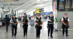 AUG 30 2014 Armed police officers patrol Heathrows Terminal 5