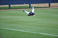 Mississippi's Tanner Mathis is unable to catch a ball hit by Arkansas' Jacob Morris during a college baseball game in Oxford, Miss., on Sunday, April 22, 2012. Morris got a triple on the play. Arkansas won 11-3. (AP Photo/Oxford Eagle, Bruce Newman)