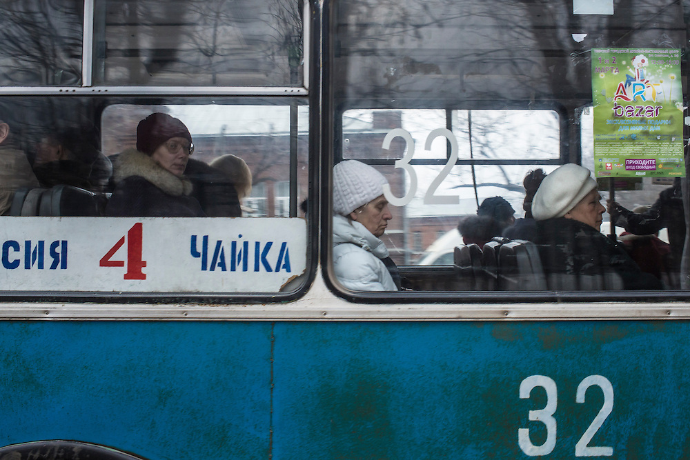 Commuters look out the window of a bus passing by Kanyayev College, where Alexander Panin studied computer science, on Tuesday, February 25, 2014 in Tver, Russia. Panin, a Russian citizen, was arrested in the Dominican Republic in June 2013, and is set to be charged by federal authorities in the US with being part of a gang which robbed bank accounts via the Internet. Photo by Brendan Hoffman, Freelance