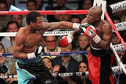 May 1, 2010; Las Vegas, NV; USA; Floyd Mayweather (orange/black) defeats Shane Mosley (black/blue) via 12 round unanimous decision at the MGM Grand Garden Arena in Las Vegas, NV.