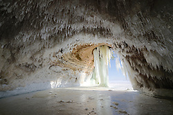 Stalactite-like icicles cover the ceiling of a cave on Grand Island, Michigan's Upper Peninsula