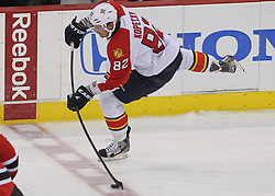 April 24, 2012; Newark, NJ, USA; Florida Panthers center Tomas Kopecky (82) shoots the puck into the zone during the first period of  game six of the 2012 Eastern Conference quarterfinals at the Prudential Center.