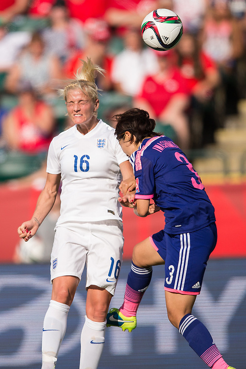 England's Katie Chapman and Japan's Azusa Iwashimizu  vie for the ball during their semi-final at the FIFA Women's World Cup at  in Edmonton, Canada on July 1, 2015. Japan defeated England 2-1 to move on to the final against the United States on Sunday in Vancouver.  AFP PHOTO/GEOFF ROBINS
