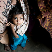 One of Mirzada's grandchildren plays around with her mothers dress making it into a veil. <br /> Karachi, Pakistan, 2011