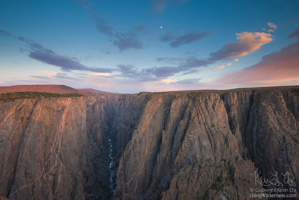 The fast-moving Gunnison River carves a deep gorge in the rock at Black Canyon of the Gunnison National Park in Colorado. Near this point, the Gunnison River drops 240 feet per mile (45 m/km), causing it to gain speed and strength to erode tougher rock. The Gunnison River drops more within the national park than the Mississippi River does between Minnesota and the Gulf of Mexico.