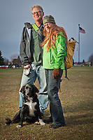 Environmental Advocates, Dennis Gann and Valerie Connor with their dog Cricket, walking home on a damp blistery day on the Delaney Park Strip, Anchorage