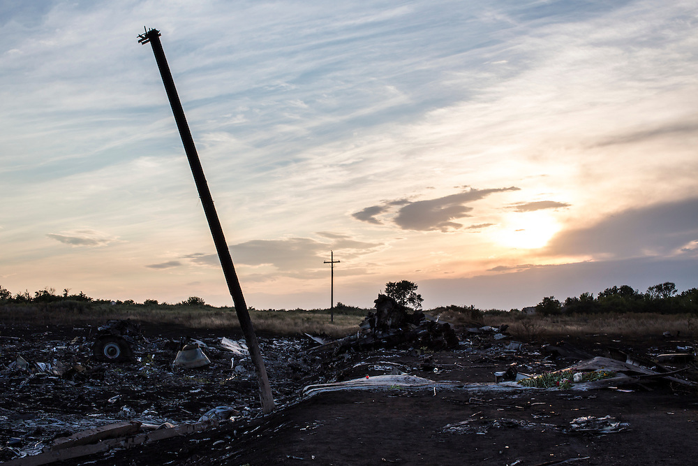 GRABOVO, UKRAINE - JULY 19: The scene of the crash of Malaysia Airlines flight MH 17 at sunset after pro-Russia separatist fighters established control of the site on July 19, 2014 in Grabovo, Ukraine. Malaysia Airlines flight MH17 was travelling from Amsterdam to Kuala Lumpur when it crashed killing all 298 on board including 80 children. The aircraft was allegedly shot down by a missile and investigations continue over the perpetrators of the attack. (Photo by Brendan Hoffman/Getty Images) *** Local Caption ***