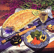 Alaska cooking. Baked wild salmon with fresh vegetable platter.