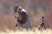 "Photographer checking his filter for dust. Elderhostel ""Southwest Photography"" Workshop Day 2. Kelly Place Cortez Colorado. Image taken with a Nikon D2xs and 400 mm f/2.8 lens (ISO 100, f/2.8, 1/750 sec)"