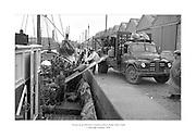 1 Deireadh F&oacute;mhair 1958<br /> Tr&aacute;laer as an bhFrainc &aacute; lucht&uacute; sa Rinn, Baile &Aacute;tha Cliath.<br /> <br /> Loading a French Trawler at Ringsend, Dublin. Trawler taking on supplies