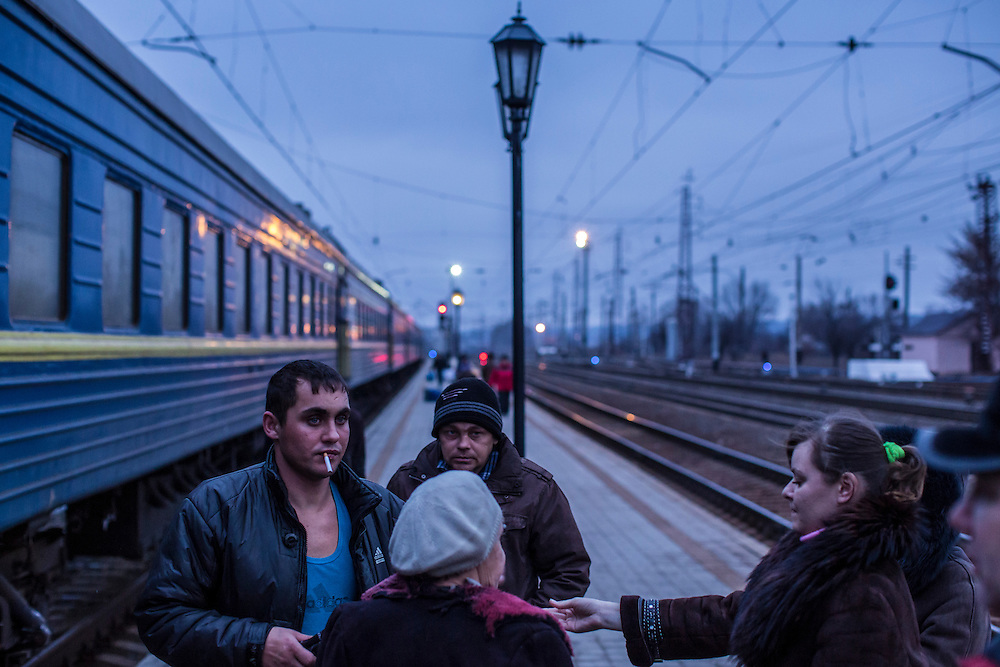 SLOVYANSK, UKRAINE - FEBRUARY 7, 2015: People displaced by fighting in the town of Debaltseve on the platform at the train station in Slovyansk, Ukraine. Many civilians have been evacuated from Debaltseve and brought to Slovyansk, where they are either given a free onward ticket or housed in a train until they can make further plans. CREDIT: Brendan Hoffman for The New York Times