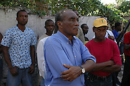 Disgruntled members of the public listen to Haitian business elites make speeches at a presidential campaign event organized by the Group 184. Port-au-Prince, Haiti, January 16, 2006.