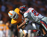 Tennessee defensive back Janzen Jackson (15) is tackled by Ole Miss wide receiver Lionel Breaux (21) on a punt return in a college football game at Neyland Stadium in Knoxville, Tenn. on Saturday, November 13, 2010. Tennessee won 52-14.