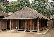 One of the most characteristic tangible cultural heritages of the Cham and also one of the most sensitive to change is their house. The Cham build their houses on the ground and arrange them in orderly rows. Their houses are surrounded by a garden with a wall or hedge. The doors open to the south-west or between. The architectural style is similar to that of the Viet with walls made of brick or a mixture of lime and shells, and covered with tiles or thatch. Houses of more than one storey are rare. In certain localities, houses on stilts are found but the floor is only 30 cm above the ground. The rooms of Cham houses are arranged according to a particular order: the sitting room, rooms for the parents, children, and married women, the kitchen and ware- house (including the granary), and the nuptial room for the youngest daughter. This arrangement reflects the break-up of the matrilineal extended family system among the Cham. The Cham living in Ninh Thuan and Binh Thuan believe that they have to perform certain religious rituals before the building of a new house, particularly praying for the Land God and asking for his permission to cut down trees in the forest. A ritual is also held to receive the trees when they are transported to the village. A ground-breaking ceremony called phat moc is also held. The precinct of the Cham traditional house is the residence site of a Cham family. It is an assembly of several houses with different functions and these houses relate closely with each others.