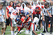 Ja-Mes Logan (85) is tackled by Cody Prewitt (25) at Ole Miss' Grove Bowl at Vaught-Hemingway Stadium in Oxford, Miss. on Saturday, April 13, 2013.